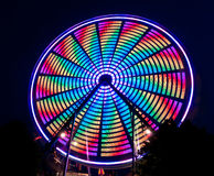 Bright Multi-Colored Spinning Ferris Wheel Stock Photos