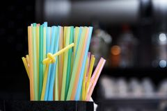 Bright multi colored straws stock photos