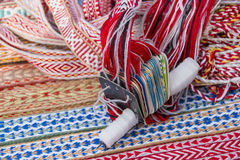 Bright multi-colored tapes. Ethnic Slavic belt for clothes. Stock Photo