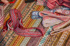 Bright multi-colored tapes. Ethnic Slavic belt for clothes. Royalty Free Stock Photography