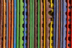 Bright multi-colored vertical lines. rough surface texture stock photography
