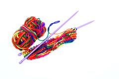 Bright multi-coloured colorful knitting wool or yarn with knitting needles on white background.  royalty free stock photography