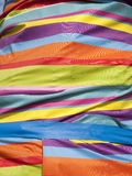 Bright multi-coloured striped cloth Stock Photography