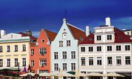 Bright multicolor houses on the Town hall square. Stock Photos