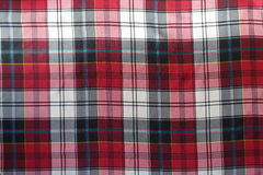 Bright multicolored chequered viscose fabric from above Stock Photos