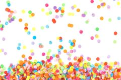 Bright multicolored confetti isolated on white background. stock photo