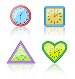 Bright multicolored different forms of clocks with reflection on Royalty Free Stock Photo