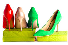 Bright, multicolored female shoes on high heels isolated on white background. Minimal fashion concept Royalty Free Stock Photography