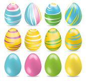 Bright multicolored and one colored Easter Eggs. Set of different Easter eggs with shadow on white background Royalty Free Stock Photography