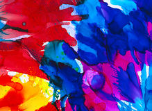 Bright multicolored paint splashes. Colorful background hand drawn with bright inks and watercolor paints. Color splashes and splatters create uneven artistic Royalty Free Stock Photos