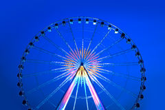 Bright multicolored spinning ferris Wheel  in blue sky. Stock Photography
