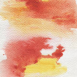 Bright multicolored splash. Abstract hand painted illustration. Autumn watercolor background in red and yellow colors Stock Photos