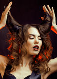 Bright mysterious woman with horn hair Royalty Free Stock Images