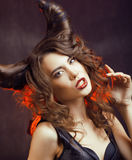 Bright mysterious woman with horn hair Royalty Free Stock Image