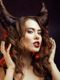 Bright mysterious woman with horn hair, halloween Royalty Free Stock Photos
