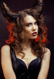 Bright mysterious woman with horn hair, halloween Stock Photography