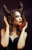 Bright mysterious woman with horn hair, halloween celebration Royalty Free Stock Photo