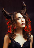 Bright mysterious woman with horn hair, halloween celebration. Close up Stock Photos