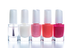 Bright nail polishes. Group of bright nail polishes isolated on white Stock Photography
