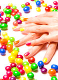 Bright nails and candies Royalty Free Stock Image