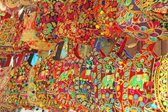 Bright national Indian colored bags are sold in the market of bazaars in India, Goa. Souvenirs Gifts India.  royalty free stock image