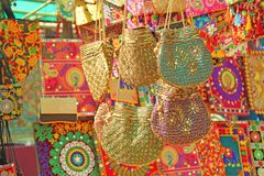 Bright national Indian colored bags are sold in the market of bazaars in India, Goa. Souvenirs Gifts India. Hand embroidery in. Gold stock images