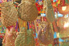 Bright national Indian colored bags are sold in the market of bazaars in India, Goa. Souvenirs Gifts India. Hand embroidery in. Gold stock photography