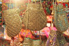Bright national Indian colored bags are sold in the market of bazaars in India, Goa. Souvenirs Gifts India. Hand embroidery in. Gold royalty free stock photos