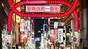 Bright neon and advertisement lights at Kabukicho in the Shinjuku, an entertainment and red-light district, Tokyo, Japan. Tokyo, Japan - August 2018: Bright neon stock photography