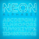 Bright Neon Alphabet on Blue Background. Vector Letter, Number and Symbol with Shiny Glow Effect Layered Separated Royalty Free Stock Photo