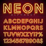 Bright Neon Alphabet on dark brick wall background. Vector number and symbol with shiny glow effect. Royalty Free Stock Photography