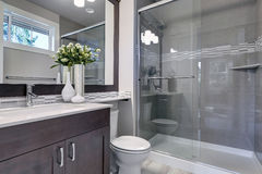 Bright new bathroom interior with glass walk in shower Royalty Free Stock Photo
