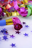 Bright New Year Party Decorations. Happy New Year party decorations with stars and noise maker, closeup Royalty Free Stock Photo