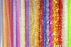 Bright New Year`s Christmas background from multi-colored tinsel Stock Photos