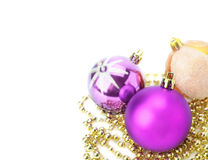 Bright New Year's toys and golden beads. Royalty Free Stock Photos
