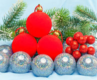 Bright New Year's toys spheres against branches of a Christmas fir-tree. Christmas still life Royalty Free Stock Photos