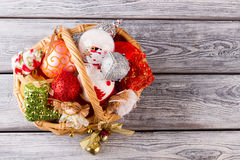 Bright New Year wicker basket. Bright New Year wicker basket with Christmas toys top view Stock Photography