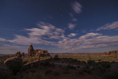 Bright night sky from the full moon over Turret Arch Royalty Free Stock Photos