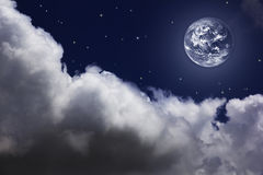 Bright night sky with a moon, stars and clouds Stock Photos