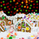 Bright Night Time Lights behind Gingerbreadh Houses during the H Stock Photo