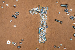 Bright number one from bolts and nuts. Photo of mozaic sign on wood background Stock Images