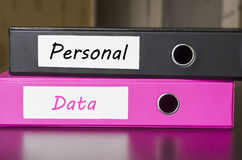 Bright office folders. Over dark background and personal data text concept Stock Image