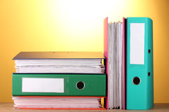 Bright office folders on wooden table Royalty Free Stock Photo
