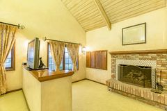 Bright, open and master bedroom additional room with vaulted ceilings and fireplace stock photos