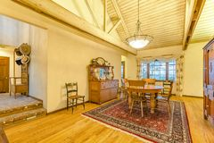 Bright, open and warm dining room with vaulted ceilings and rug. Wonderful California home in San Diego county. Real estate listings with powerful visuals royalty free stock image