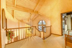 Bright, open and warm indoor balcony with vaulted ceilings royalty free stock photography