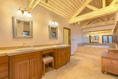 Bright, open and warm master bathroom with vaulted ceilings and stock photo
