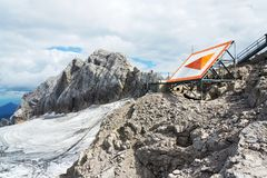 Bright orange arrow near cable car station on Dachstein glacier. Styria, Austria Royalty Free Stock Images