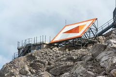 Bright orange arrow near cable car station on Dachstein glacier. Styria, Austria Royalty Free Stock Photography