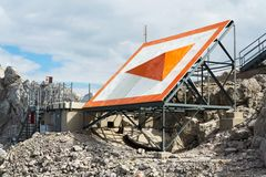 Bright orange arrow near cable car station on Dachstein glacier. Styria, Austria Stock Images
